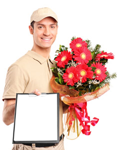 Delivery boy delivering bouquet of flowers and holding a clipboa